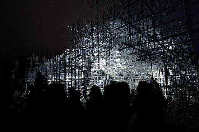 Sou Fujimoto Serpentine Pavilion Intervention by United Visual Artists. UVA, in collaboration with My Beautiful City, transformed Sou Fujimoto's Pavilion, bringing the cloud-like structure to life with an electrical storm.