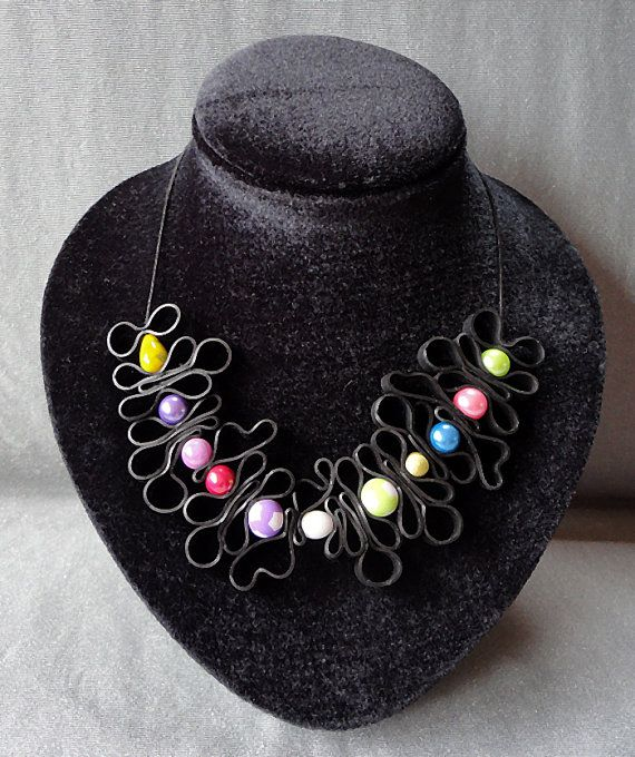 Necklace rubber with colored beads. Colored chain. Rubber
