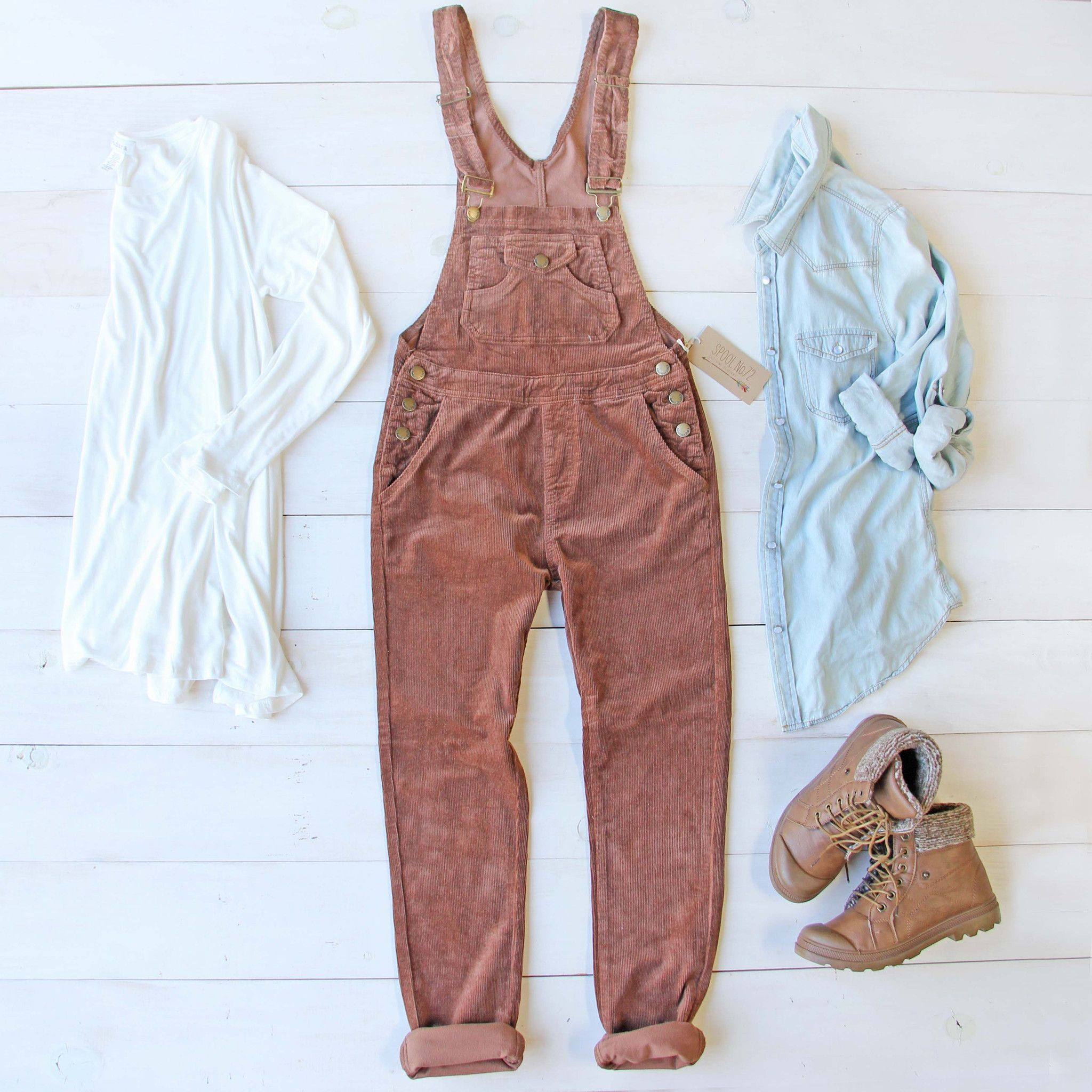 f6fbe146f5 Sweet rust tones adorn these cozy corduroy overalls. A soft brushed corduroy  base pairs with a traditional overall styling