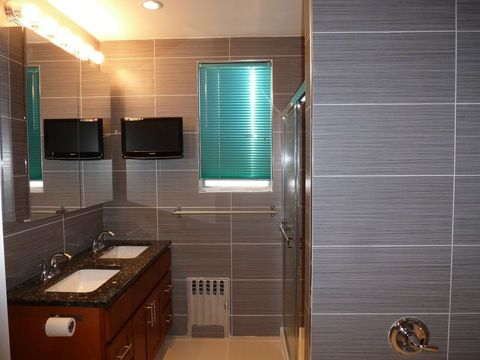 Modern Bathroom With Black Granite Countertops Designmine Bathroom Remodel Cost Bathroom Renovation Cost Bathroom Cost