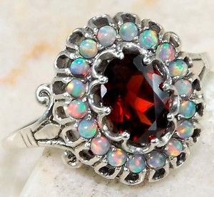 fire opal and garnet gorgeous ring ::Looks like I need to start a new board for jewelry...
