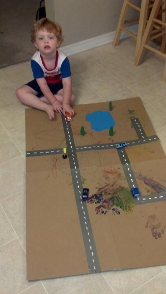 I created this track for my son's cars out of 4 pieces of cardboard taped together.  It was inspired by another pin I saw on pinterest.  My son painted and used crayons to color the cardboard.  I used duck tape and white out to create a track and blue construction paper and glue to make the lake.  I plan on creating buildings and houses out of other things laying around the house.  My son has gotten hours of fun and entertainment out of this simple project.