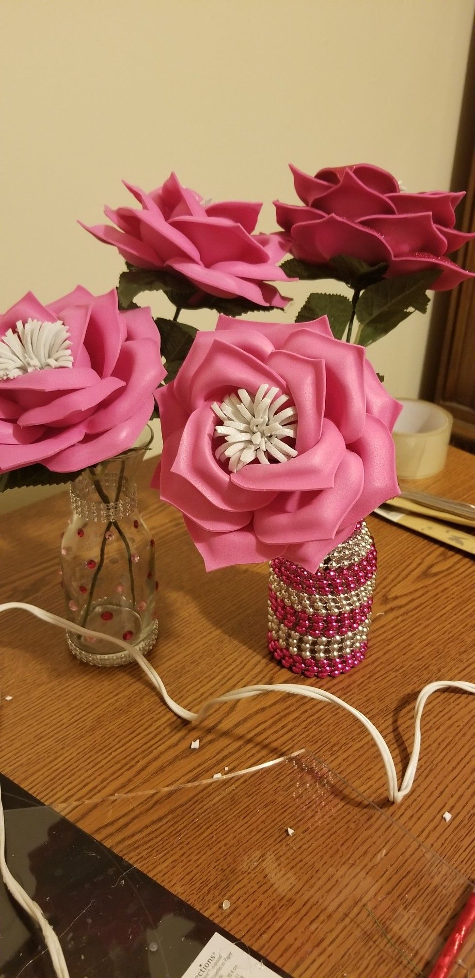 Center pieces with handmade foam flowers and handmade vases