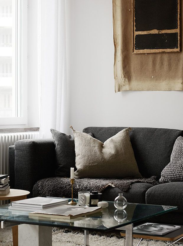 Grey sofa and linen cushion covers in