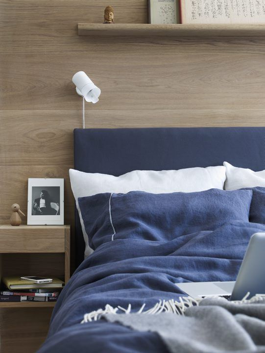 Gorgeous colour mix for a relaxed bedroom design - navy blue textiles and cafe au lait wood paneling - Norrgavel