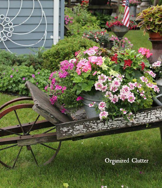 rustic garden wheelbarrow 2015 via organizedclutter   junk
