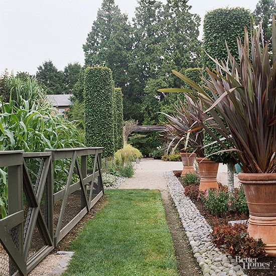 Create a contemporary feel with interesting rails. In keeping with the long, straight lines and tightly clipped formality of the rest of the landscape, this fence uses horizontal wood rails strengthened by diagonal boards in a triangular pattern. Test Garden Tip: Attach wire mesh to the inside of your fence to keep out unwelcome critters