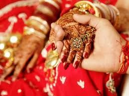 Indian Wedding Holding Hands