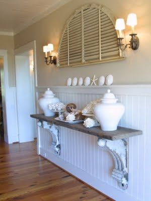 DIY: A rustic shelf with sea life, an old shutter above and beautiful wainscoting below.