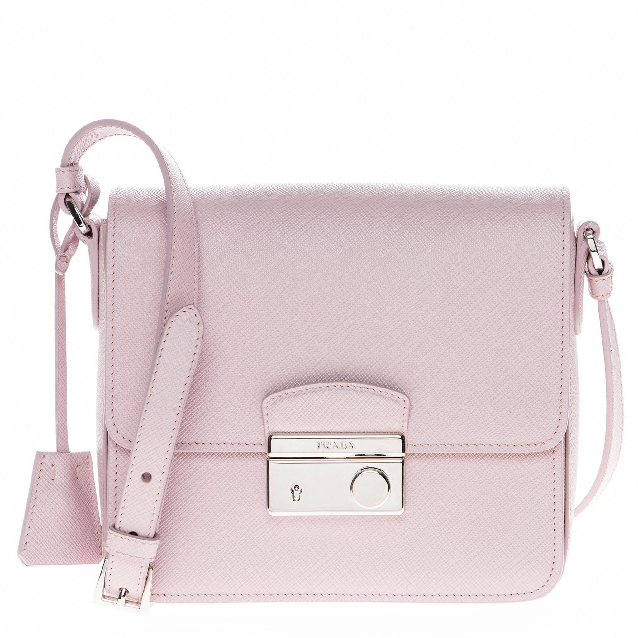 ... inexpensive this compact crossbody handbag by prada showcases a light  pink saffiano leather construction. paired ... 6604262a39317