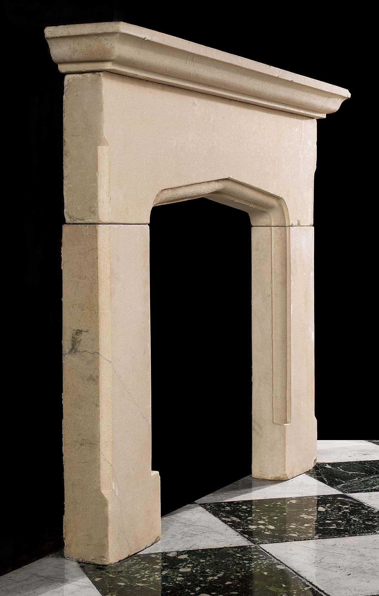 An Antique Tudor Gothic Style Limestone Mantel Fireplace