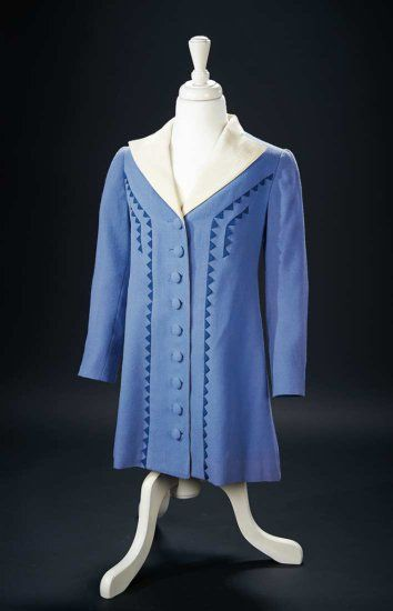 Wedgwood-Blue Woolen Coat with Sawtooth Accents Worn by Shirley Temple at Events Of a rich wedgewood-blue color, the lightweight woolen coat with self-covered buttons features suit lapels of ivory silk faille, and is decorated with vertical bands of dark blue sawtooth-shaped appliques.The coat was worn by Shirley Temple for various social and publicity events in the late 1930s. Z