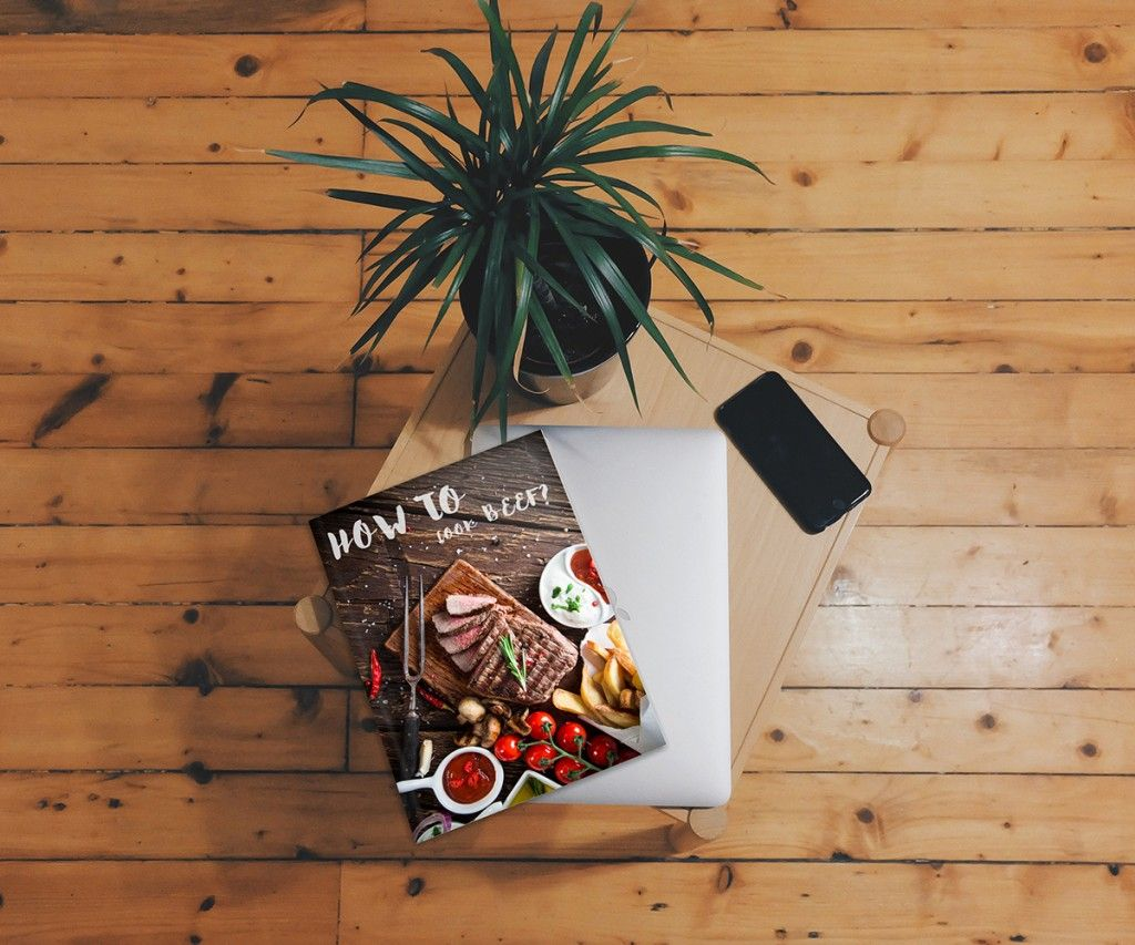 Beautiful indoor shot showing a magazine cover on a table. PSD with ...