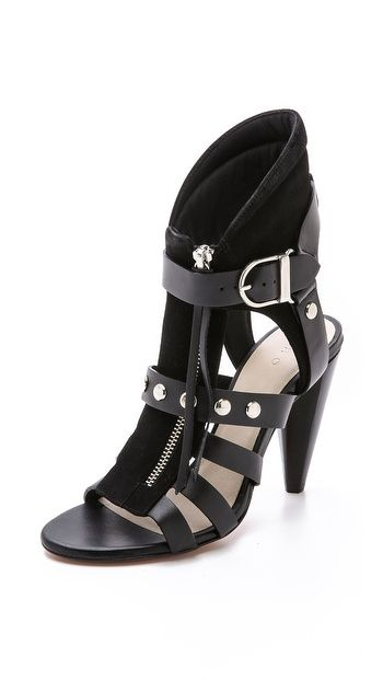 Polished hardware and buckled straps lend cool moto style to these striking IRO booties. Light padding shapes the curved collar, and a tassel pull secures the front zip. Stacked cone heel and leather sole. Leather: Calfskin. Made in Italy. This item cannot be gift-boxed. Measurements Heel: 4in / 100mm Shaft: 5.5in / 14cm