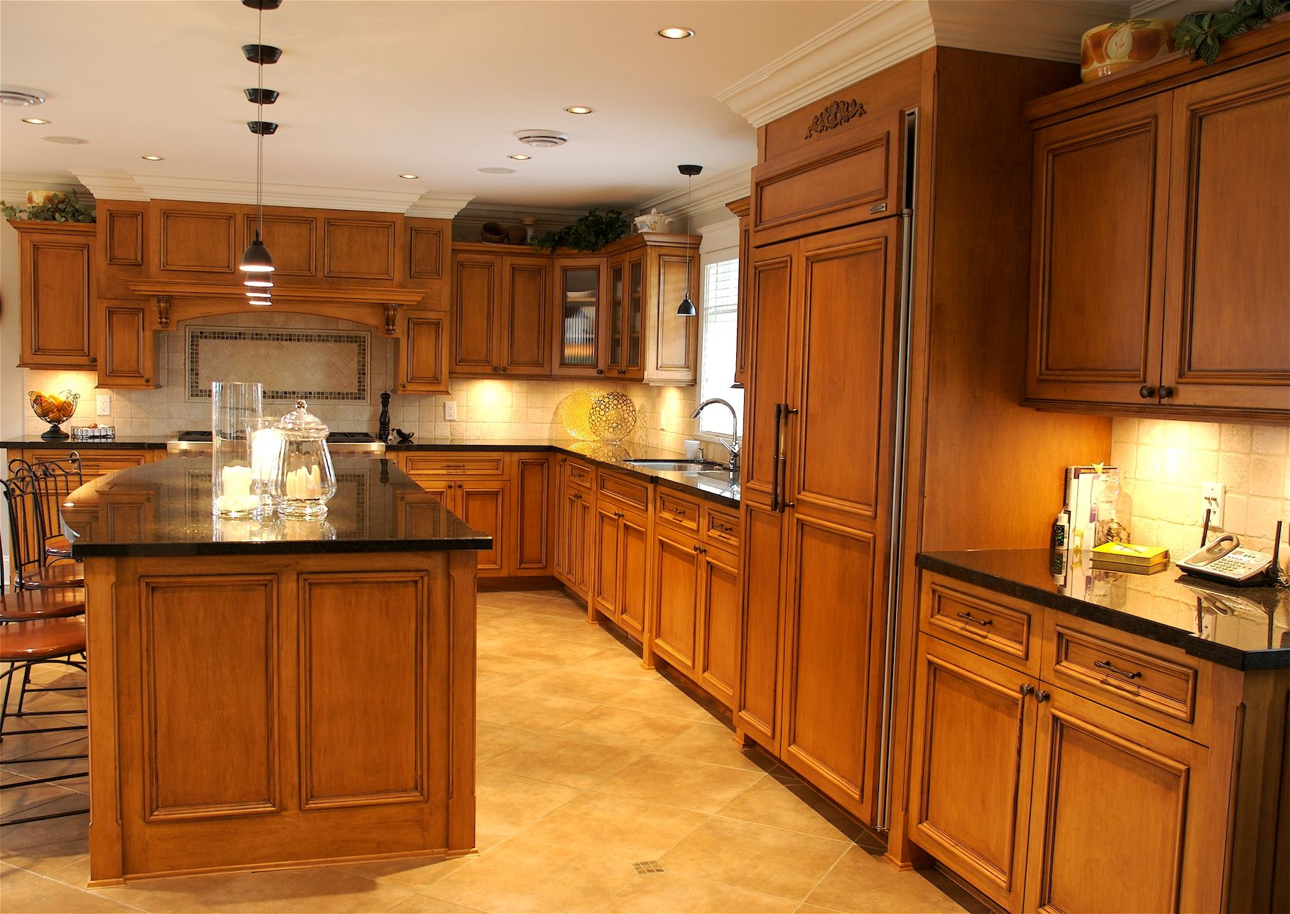 Maple cabinets with black countertop and light tile ... on Backsplash Maple Cabinets With Black Countertops  id=38167