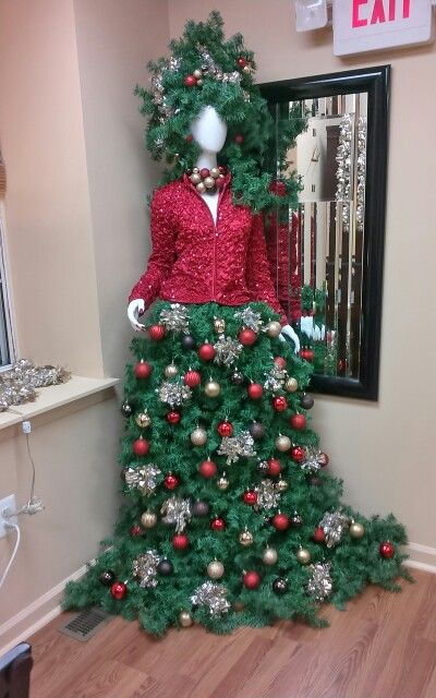 Christmas Tree Designed Around A Manikin By The Staff At Hotlooks Hair Design Salon In W Whimsical Christmas Trees Christmas Tree Dress Manequin Christmas Tree
