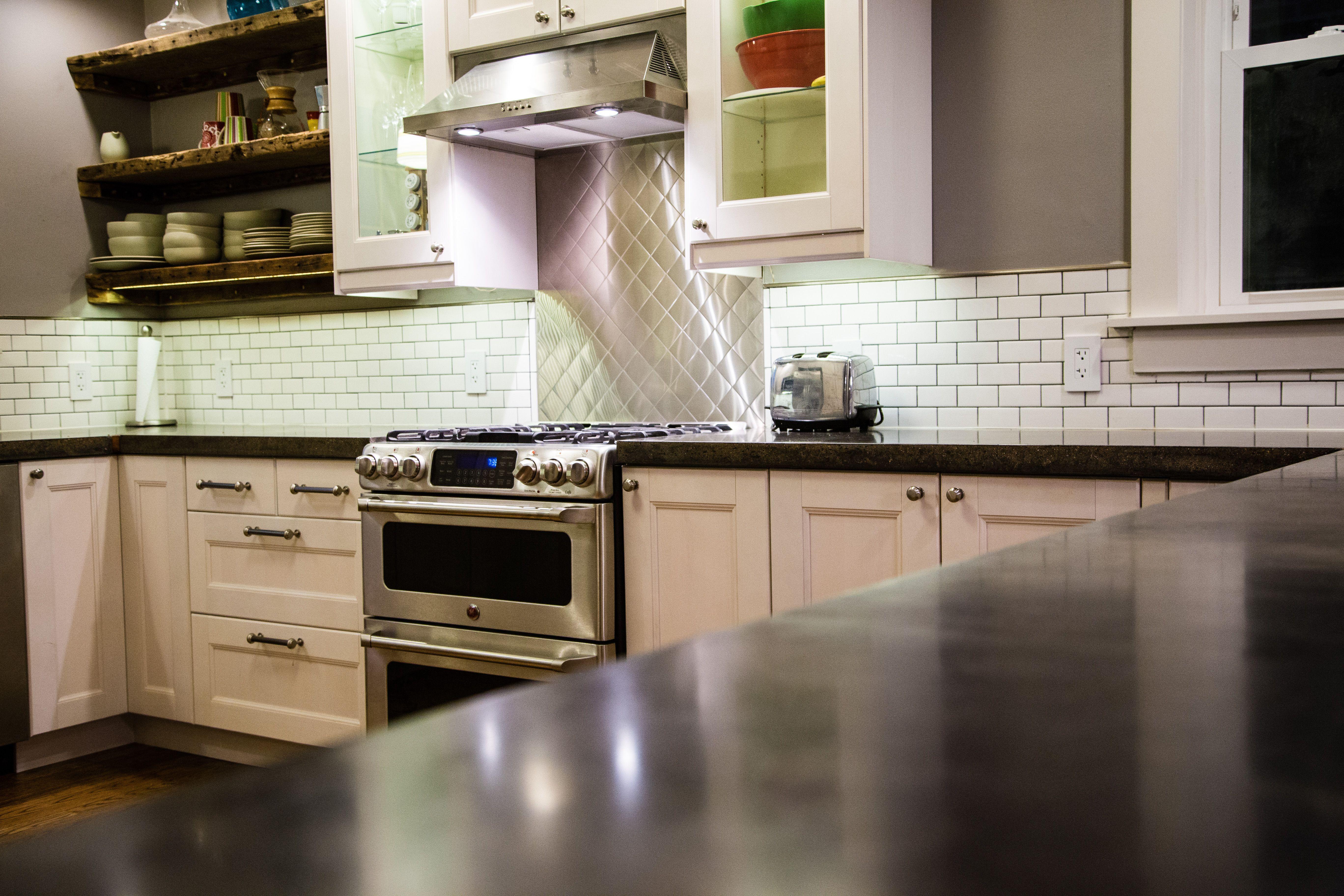 Kitchen rehab diyhomemade concrete counters subway tile kitchen rehab diyhomemade concrete counters subway tile backsplash reclaimed wood shelves dailygadgetfo Images