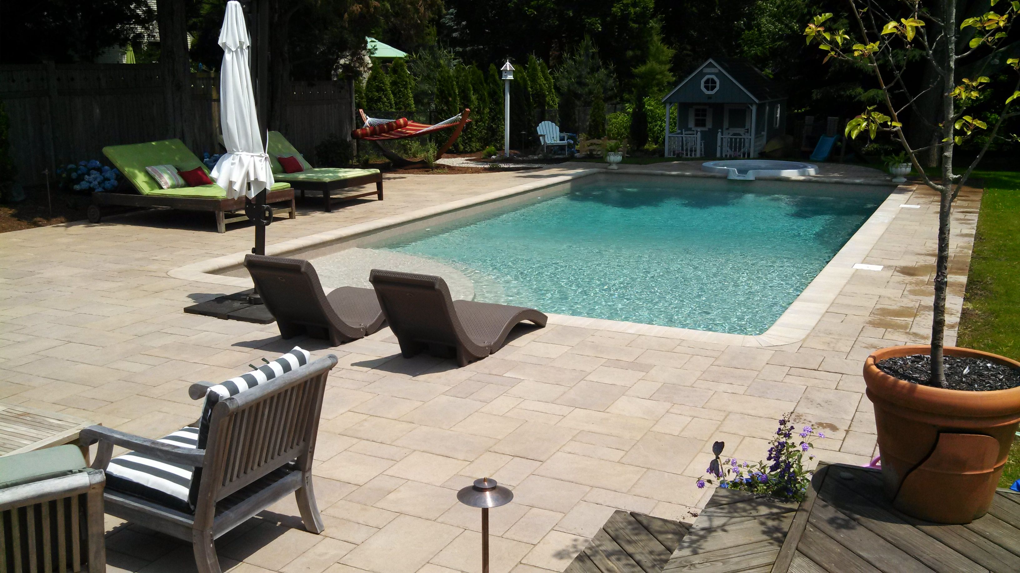 pavers maximize the long linear profile of this pool surround