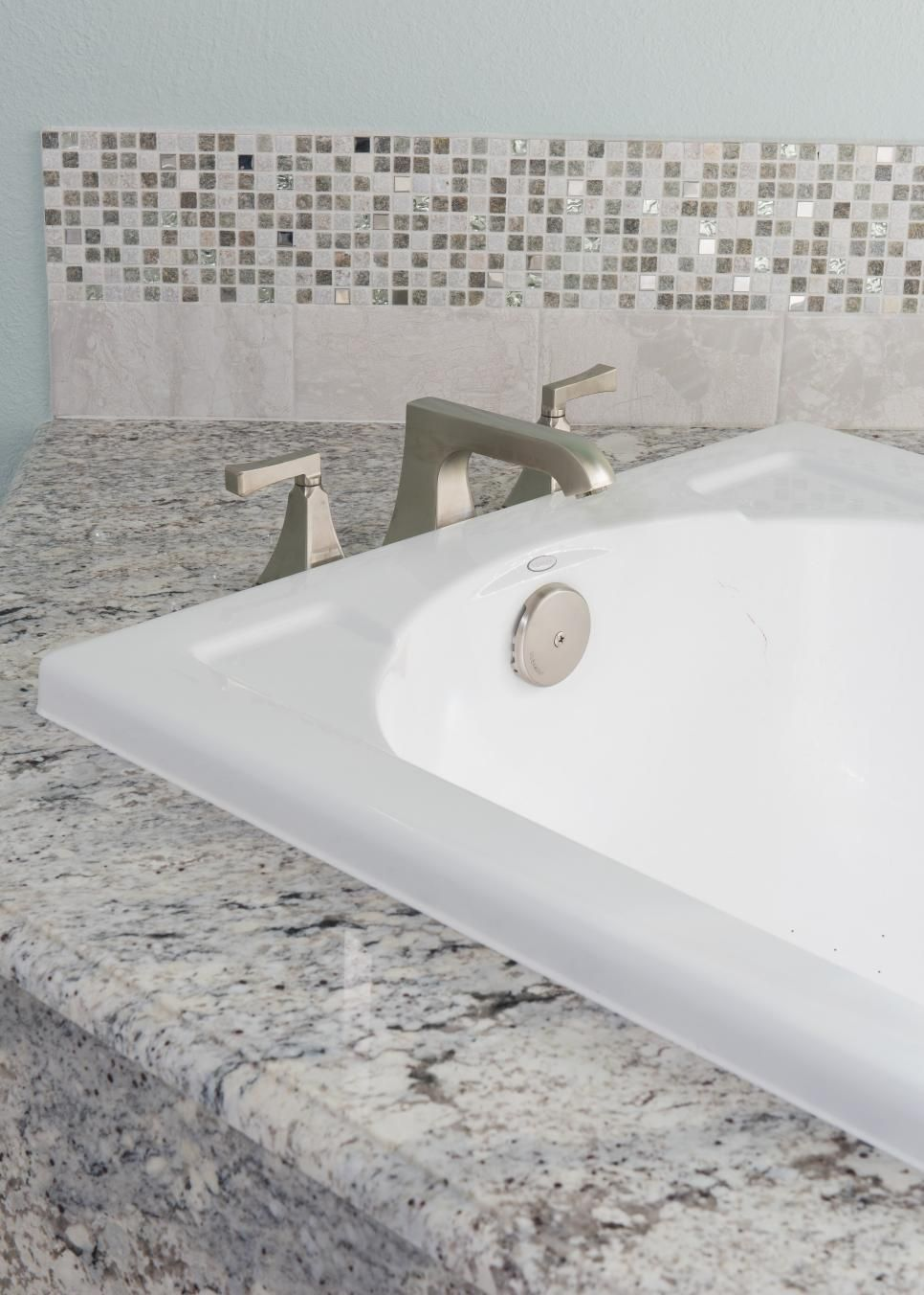 A close look at this bathroom sink showcases the heavy stone ...