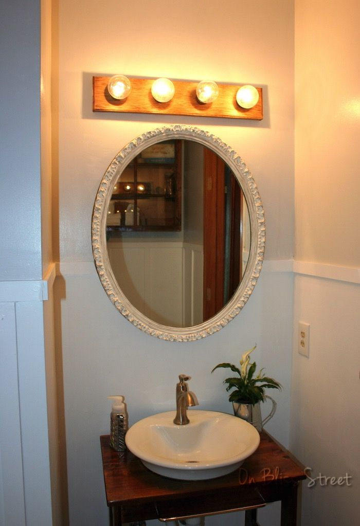 Upgraded Hollywood Vanity Light Fixture Strip With Wood Above Oval Mirror Simple Bathroom