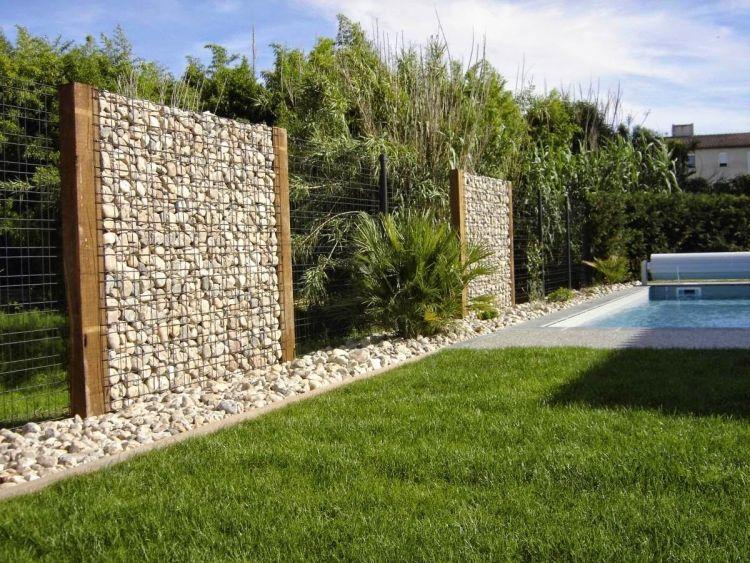 Gabionenwand gabionenzaun moderne gartengestaltung hecke for Gartengestaltung zaun