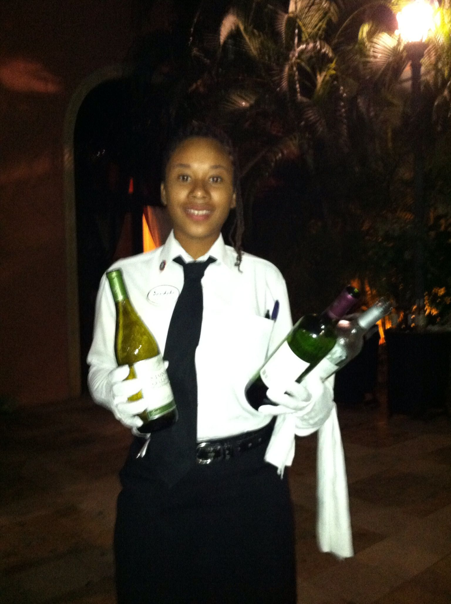 White Glove Service Offering A Glass Of Wine At Sandals