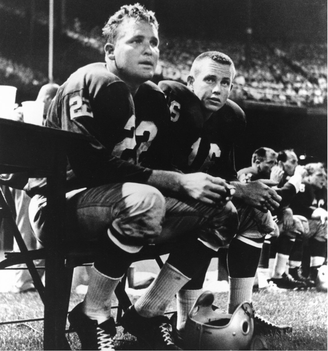 At right, Jack Kemp, with teammate Bobby Lane, while playing for the Pittsburgh Steelers.
