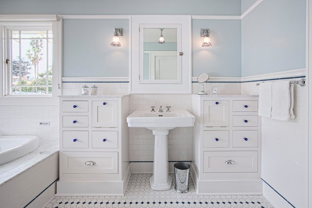 pedestal sink or vanity in small bathroom%0A In white with accents of cobalt blue  the new master bath is outfitted with  a soaker tub and pedestal sink  a towel warmer  and a separate shower