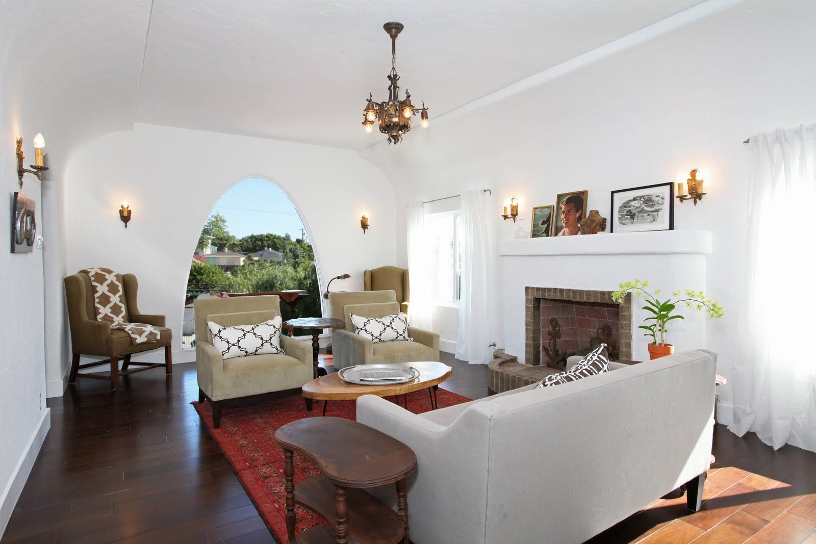 Living room of a Spanish style Los Angeles area house features a ...