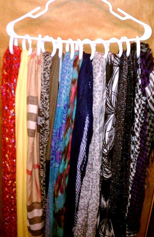 Organization of the Scarves- shower curtain rings- on a hanger.