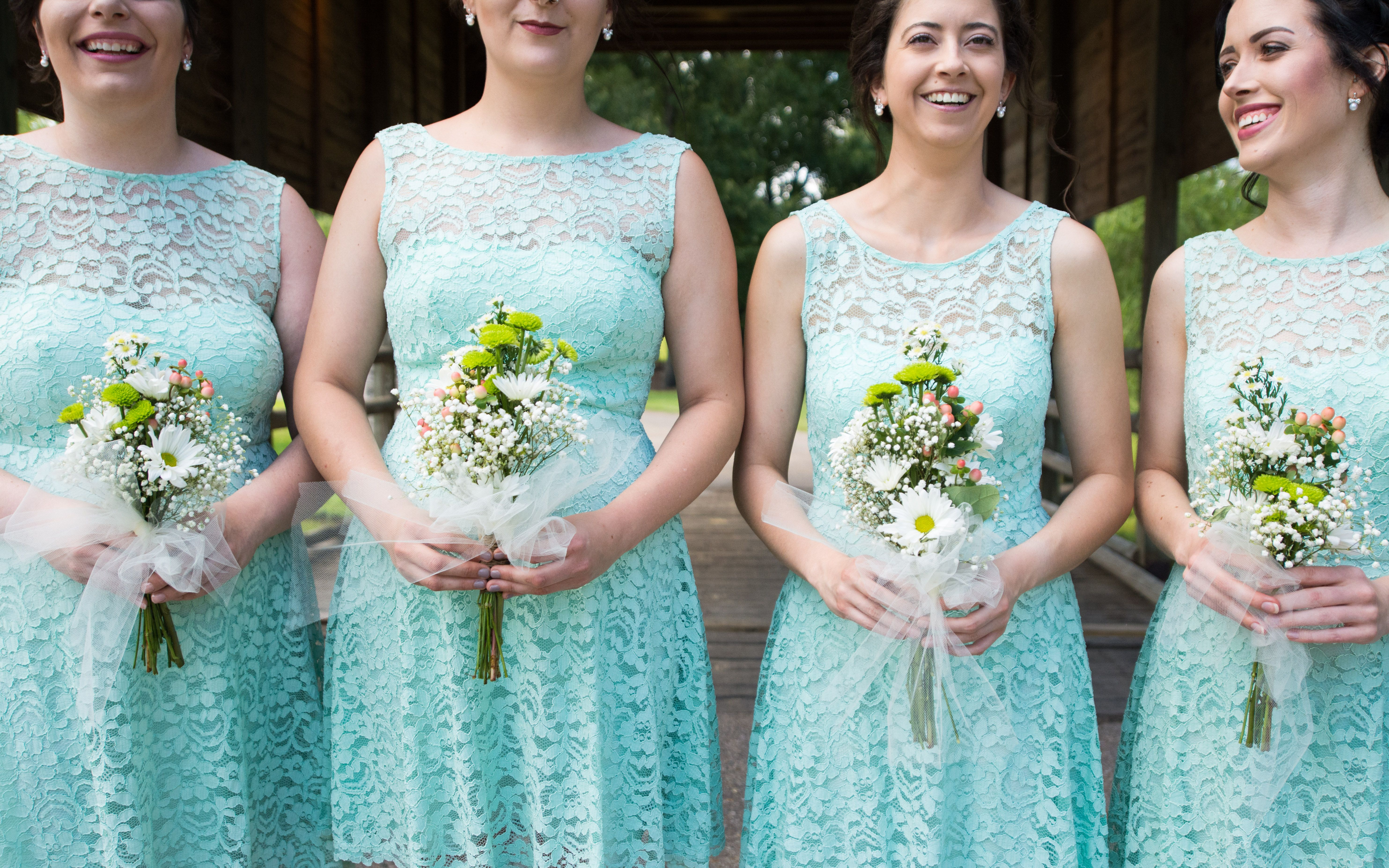 Turquoise lace bridesmaids dresses with wildflowers at Classic Meets ...