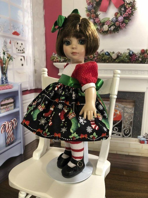 The bodice and skirt are lined with white cotton fabric. The back closes with tiny buttons over hidden snaps. The sash is green satin ribbon tied in a bow in the back. HAIR BOW: Made from green satin ribbon and a silver metallic bow with a red bead in the center. | eBay!