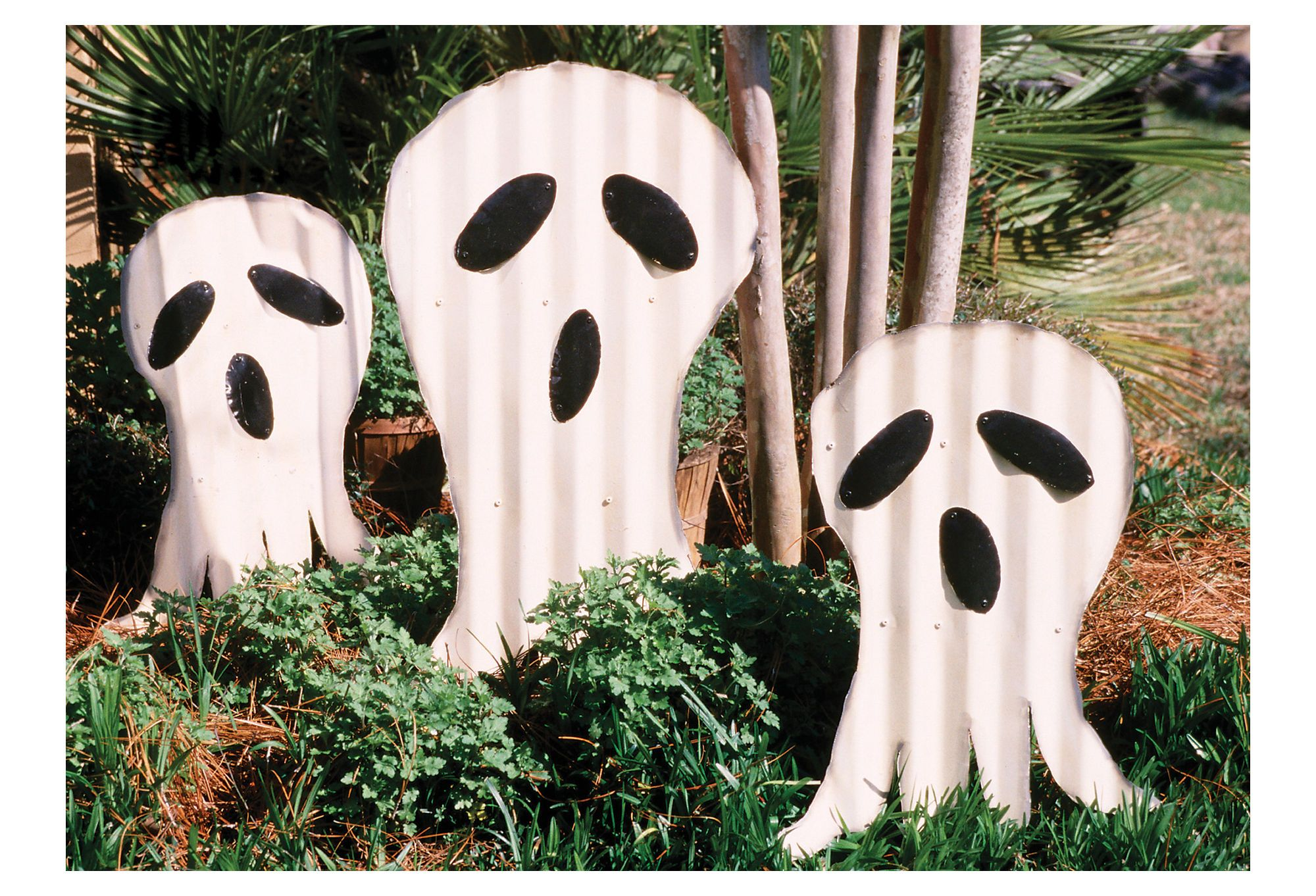 painted metal ghosts yard art halloween