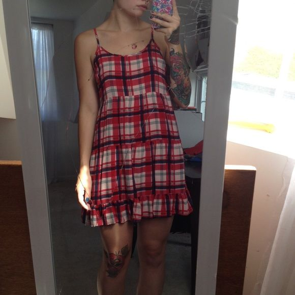 Plaid Dress Cute little plaid dress. Adjustable straps. Looks cute with a long sleeve shirt underneath or slouch sweater for fall! Dresses