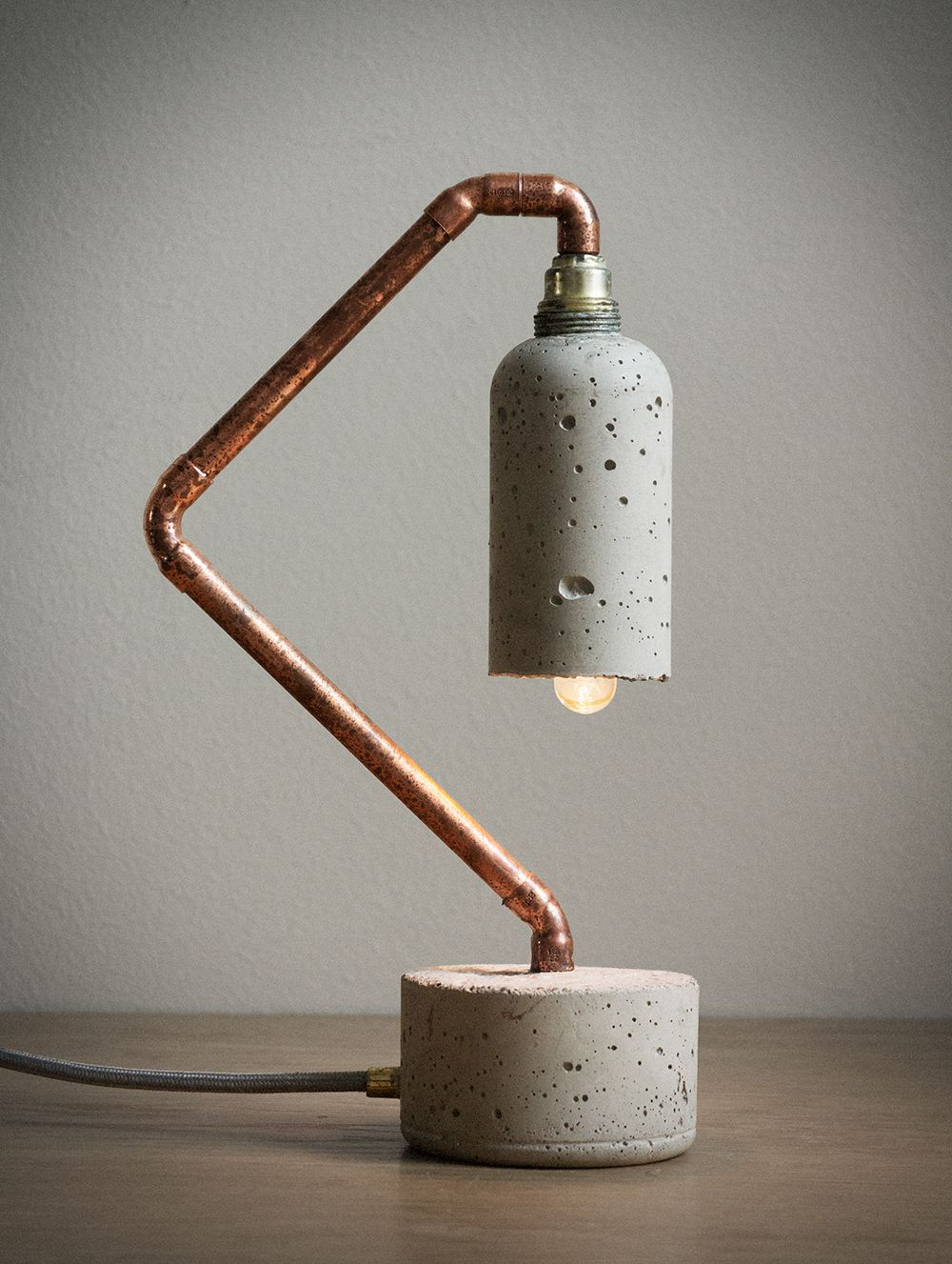 Concrete and brass lamp.