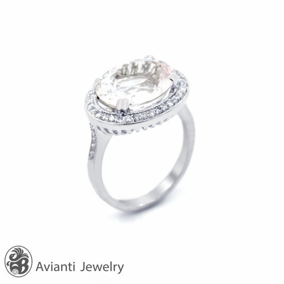 """The soft glow of pink Morganite really wows in this statement sized ring.  Large Morganite 6.67 carats, brilliant oval cut, horizontally set, glimmers among pave set diamonds, set in 14 karat white gold. This ring is from our """"Blushing Rose"""" collection. Morganite Ring, Morganite Engagement Ring, Morgantie and Diamond Ring, White Gold Engagement Ring, Diamond Halo Ring 