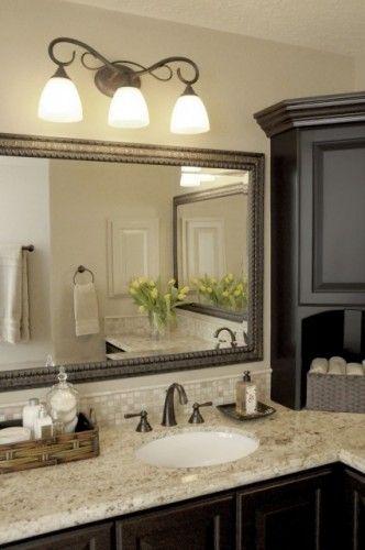black cabinetry; counter, backsplash, mirror; cool tones