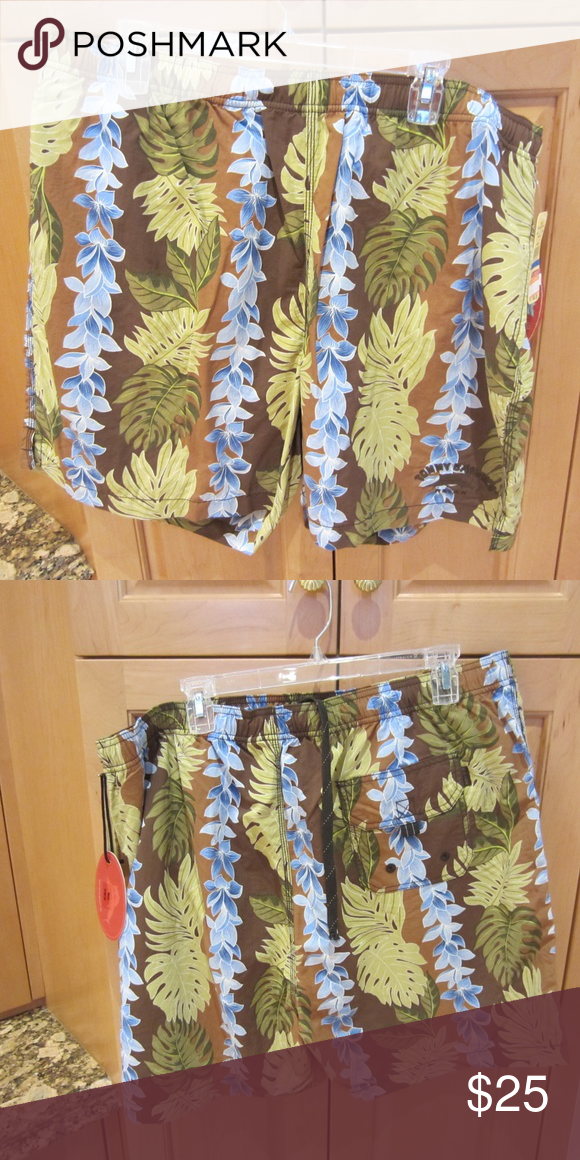 Tommy Bahama Men's Bathing Suit Tommy Bahama lei ing low men's bathing suit; 100% nylon with mesh lining; 2 side pocket; rear flap pocket; Color is buffalo (brown) with green leaves and blue flowers; brand new Tommy Bahama Swim Swim Trunks #mensbathingsuits