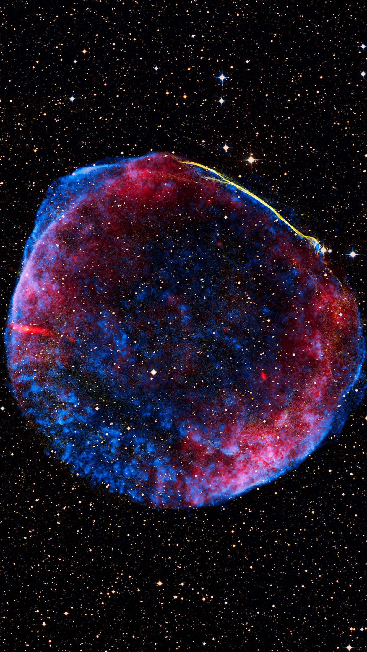 This remarkable image was created from pictures taken by different telescopes in space and on the ground. It shows the thousand-year-old remnant of the brilliant #SN1006 #supernova, as seen in radio (red), X-ray (blue) and visible light (yellow).