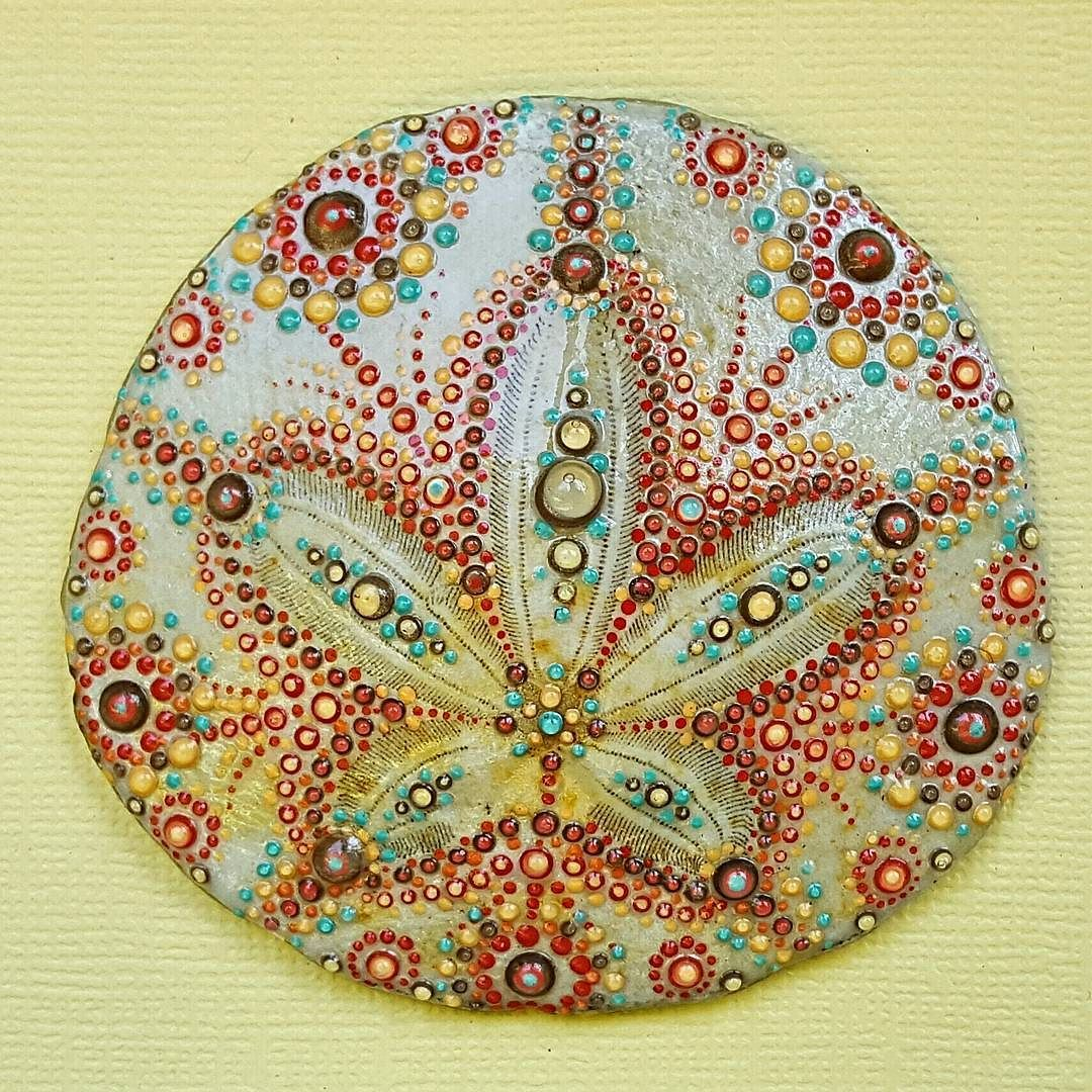A close up of the detail on the latest painted sand dollar