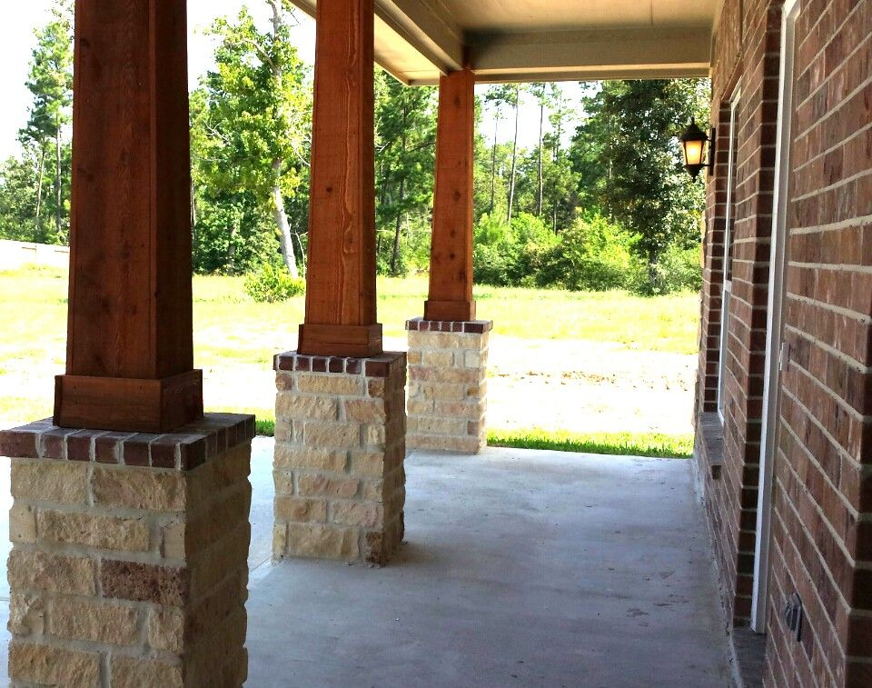 Give cedar columns a slight taper the wider base looks for Rustic porch columns