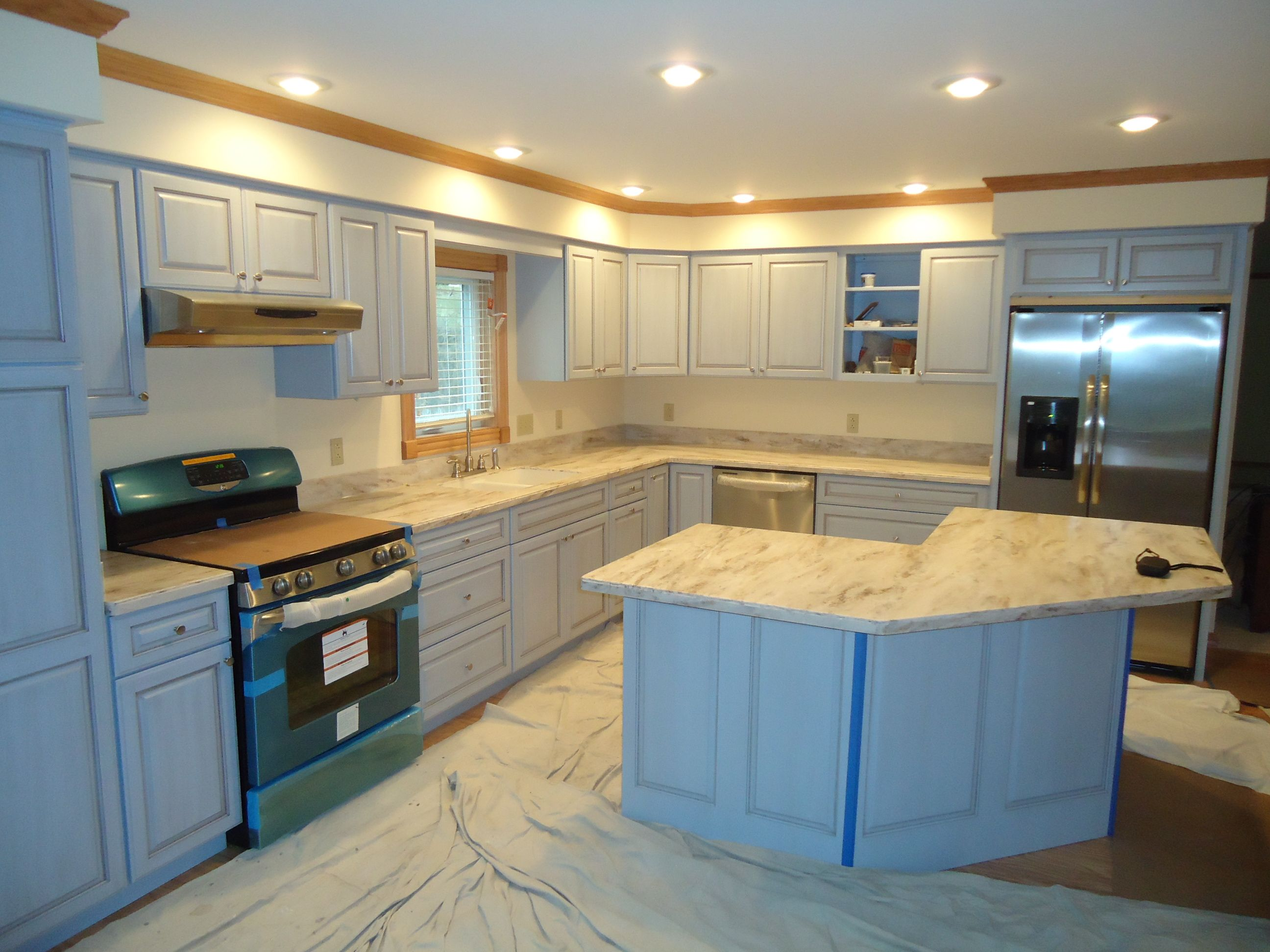Kitchen was completed with corian sandalwood solid Solid surface counters