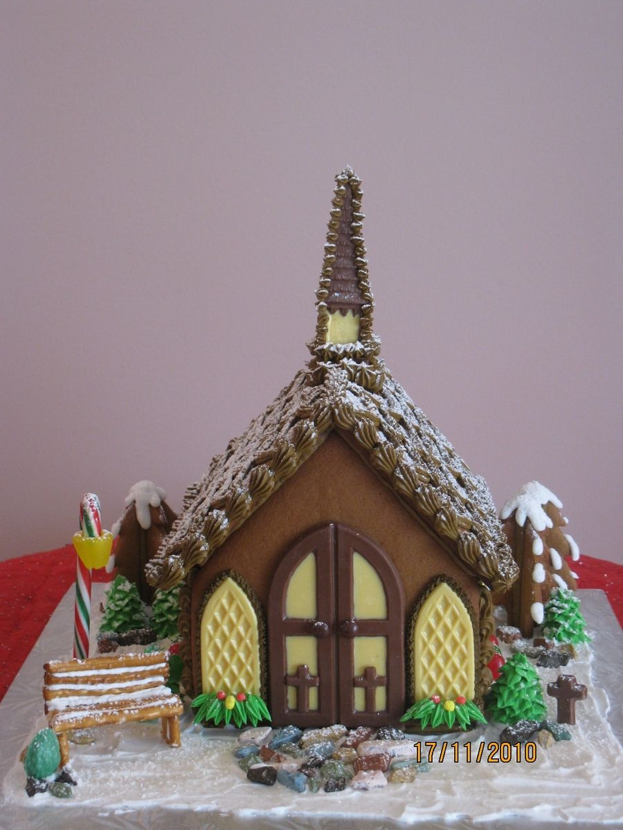 Chocolate steeple, windows and door, and angel on back wall ... on church cakes, church family house, church snow, church autumn, church candy, church cupcakes, church country gingerbread recipe,