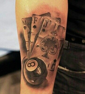 Great job! Worn cards with eight ball tattoo