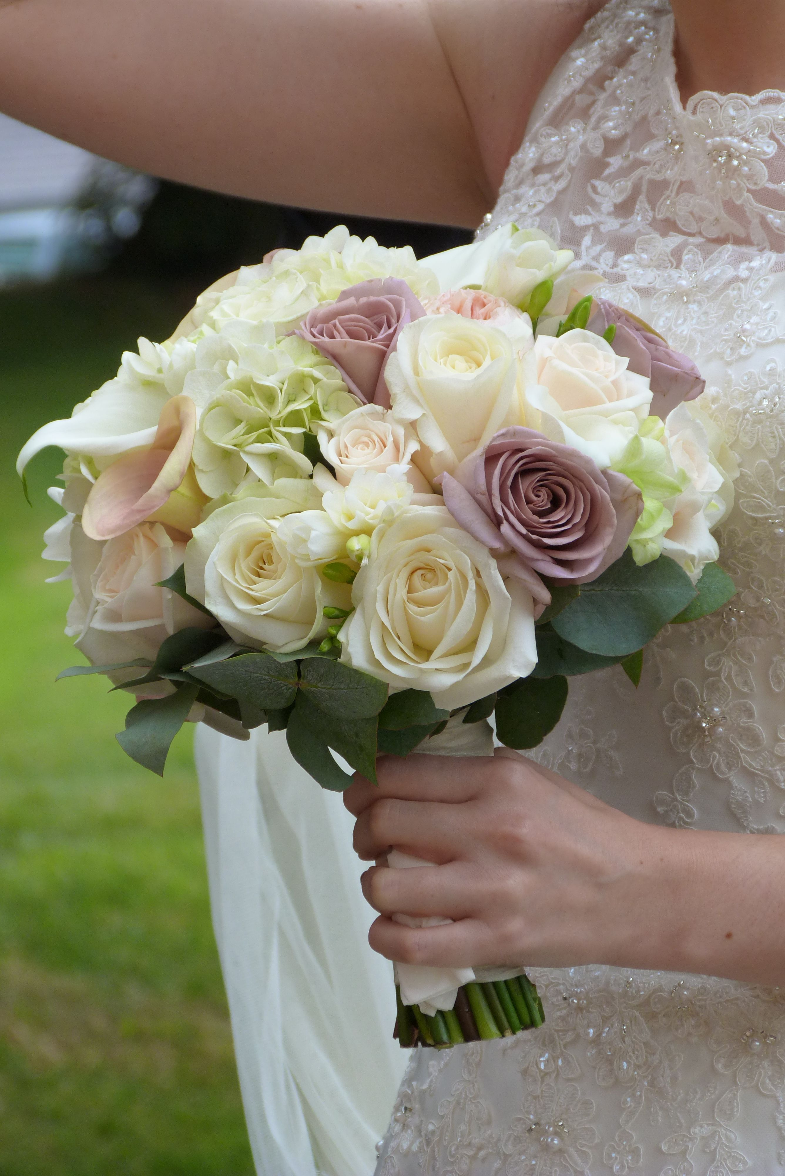 A vintageinspired pastel bridal bouquet including uamnesiau roses