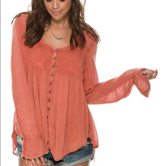 Free peopleshirt. Small. Cheaper on mercari Beautiful color is Pink Sand bluebird baby doll style flowy top that is perfect for any event or season! New with tags small. Free People Tops