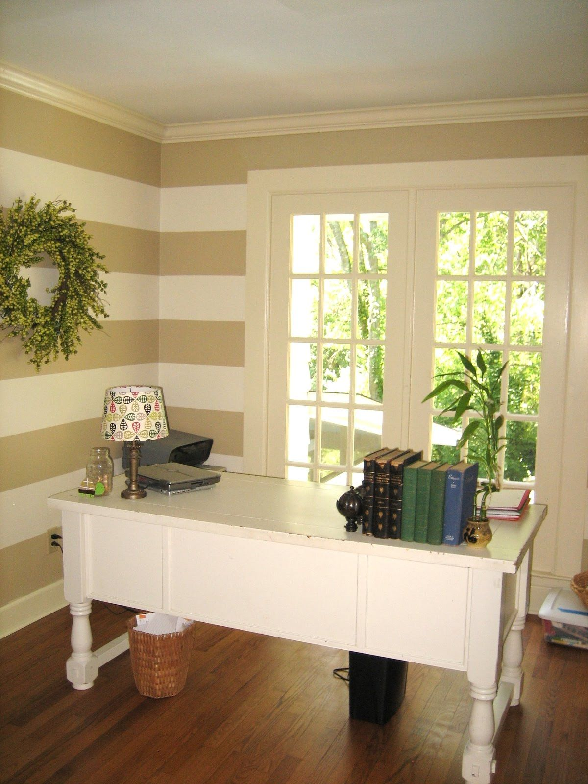 Striped walls in a home office. Love the french doors to let in lots ...