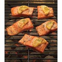 Grill wild caught salmon with a slice of fresh lemon on top