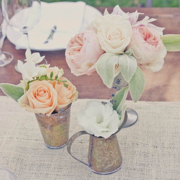 Create mini arrangements in vintage cups with soft-hued roses.Photo courtesy of Kelly Oshiro Design