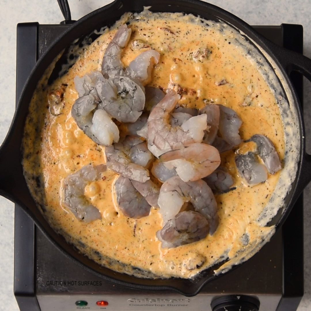 This Tuscan Shrimp Skillet recipe is spicy and made with a light creamy sauce, garlic, and sun-dried tomatoes. A restaurant quality recipe that's easy to make, keto-friendly, and the whole family will enjoy.